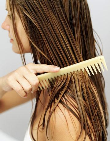 combing wet hair with a wide toothed comb.jpg