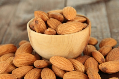 bigstock-Almond-in-wooden-bowl-on-wood-48279077+144.jpg