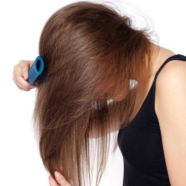 1433811455-woman-brushing-thinning-hair-falling-out